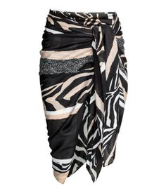 Zebra print. Sarong in airy woven fabric with a printed pattern. Size 51 1/4 x 59 in.