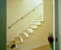 Baroque Stair Handrail vogue Austin Contemporary Staircase Decorators with banister baseboards neutral colors open staircase railing white wood wood flooring wood trim wooden