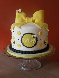 Baby Shower with a Bee theme -cake w/cupcakes that match to feed more people!