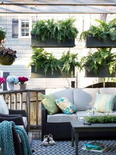 An empty deck is transformed into a party-ready living space with a mix of bold accessories, clever planters and smart furnishings.