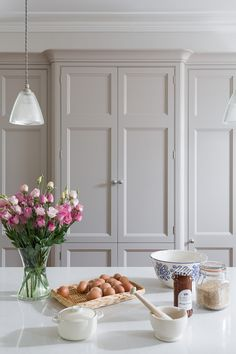 This neutral shaker kitchen by Jones Britain features our Small Prismatic Pendants over both the island and the kitchen table. The vintage inspired design reflects the traditional style of the kitchen while the minimal grey colour scheme is a more … Shaker Kitchen, Bespoke Kitchens, White Paneling, Light Project, Kitchen Styling, Pendant Lighting, Kitchen Design, Wall Lights, Larder