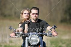 http://www.istockphoto.com/stock-photo-494235-motorcycle-couple-0031.php?st=f4d3424