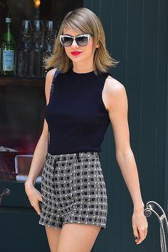 wwd Taylor Swift rocks a pair of Swarovski sunnies.