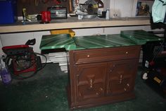 This isn't a good pic but the chest with a top that opens started out as a pretty sad looking thing.  A coat of paint, polished the handles and did faux marble on the top.  It will be used to serve drinks at my clients house on the patio.  Eventually it will come to me, take on a whole new look and be used for a rolling sewing/craft station.