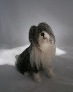 found on the website FELTEDFIDO, I would love to learn how to do dry felting to make these adorable mininatures
