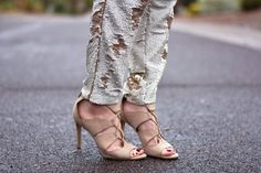 gold sequin pants with nude heels