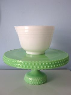 be still my beating heart.  this green milk glass cake stand is UH-mazing. I just got the same white pyrex bowl at SA.