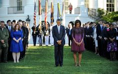 President Obama and first lady Michelle Obama observed a moment of silence at the White House Tuesday morning to mark the 11th anniversary of September 11.