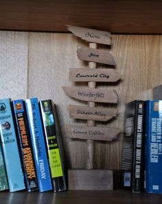 Need some pointing in the right direction? This signpost bookend may help. | 27 Incredibly Clever DIYs All True Book Lovers Will Appreciate