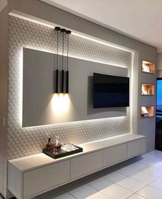 5 Amazing Ways to Upgrade Your Living Room TV Wall - Are you bored with the same old flat screen arrangement? Then why not try one of these five amazing ideas for your living room TV wall. Tv Unit Decor, Tv Wall Decor, Wall Tv, Bedroom Tv Wall, Tv Area Decor, Tv Wall Panel, Fireplace Tv Wall, Fireplace Modern, Wall Decor Lights