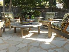 Flagstone with decomposed granite as a filler. Patio With Flagstone Look Landscaping idea.