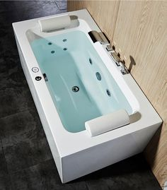 Freestanding Whirlpool Tub Offers An Ample Deck Space For