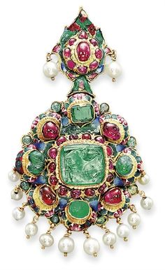 AN INDIAN MULTI-GEM, ENAMEL AND PEARL PENDANT Designed as a polychrome enamelled rosette centering upon a square-shaped foil-backed emerald within a cabochon ruby surround and a cabochon emerald and ruby outerframe, suspending a graduated pearl fringe, to the similarly-set foliate surmount, the reverse depicting an enamelled naturalistic scene, 19th century