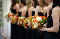 Dark blue bridesmaids dresses and a really interesting and diverse floral arrangement