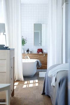 The beautiful bedroom&bathroom in the Norrgavel House at Kafferosteriet Sweden