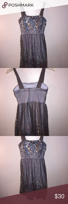 Delia's gray and silver party dress Delia's gray and silver party dress. Lined with a slip and tulle straps.  Lays just above the knee or at the knee.  In great condition and worn one time. Delia's Dresses Midi