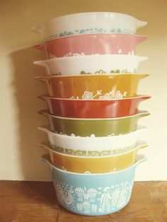 vintage pyrex.  My grandma is giving me her pyrex mixing bowels just like the bottom blue one.  She received these as a wedding present.