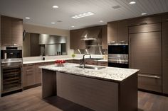 Modern Warm Kitchen - counter combination, wood cabinets