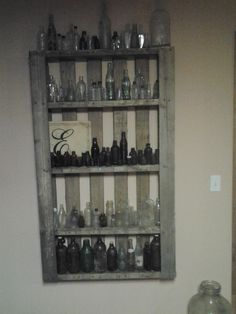 Old bottles we found behind my grandfathers shop and a pallet from Anthonys work.