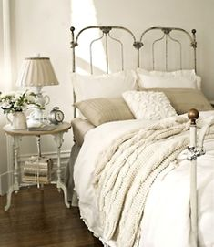 Antique French Bedroom: This antique cast-iron bed sports a cable-knit throw from the Martha Stewart Collection and a duvet cover by French Laundry Home. An Anthropologie teacup lamp sits atop the turned-leg nightstand for a graceful, elegant touch. Home, Bedroom Design, Bedroom Inspirations, Bed, Victorian Home Decor, Bedroom Colors, Country House Decor, Bedroom Vintage, Iron Bed
