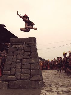 The traditiona stone jumping (lompat batu) in Southern Nias in the village bawoemataluo (hill of the sun). It is worth seeing.