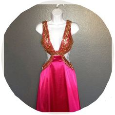 Hot pink prom dress Beautiful hot pink dress with gold beading on the upper side of the dress! Very flashy and sexy! Open back that buttons and zips up! Only worn once. Has a couple of stains/ dirty spots.. Needs to be taken to the dry cleaners and I'm pretty sure it will come off, but not 100% sure. It's an XS which would fit mostly a 2 ! I'm 5'3 + with heels it fits perfect !!  ❌Do not ask for my lowest, make an offer instead  ❌Serious Buyers ONLY  ❌ No Trades Dresses