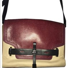 Vince camuto crossbody Colorblocked Vince Camuto Crossbody.  Wine/black/ beige/ taupe colored.  Gunmetal hardware.  In good condition. Small scuffs (pictured).  Comes with dustbag.  Check out my closet for more great deals, Vince Camuto Bags Crossbody Bags