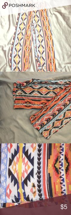 Light Weight Cloth Pants Fun Native inspired print. Gently used. Light fade. A few loose threads. Black stain on bottom of pants leg. Bottoms Casual