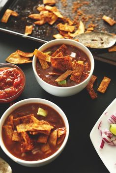 Loaded Veggie Nacho Soup - partial grocery list, adapted: onion, garlic, Mexican spices, tomato paste or crushed tomatoes, salsa, mild chilis, black beans, sprouted corn tortillas, spices for baked tortilla 'chips'| Minimalist Baker Recipes