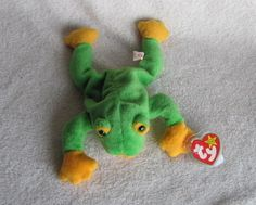 Ty Smoochy the Frog Beanie Babies Baby Retired.....smoochy is the one that my girl's favorite...always had him with her when she slept. ♥