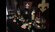Black and Gold New Orleans Saints 50th Birthday candy buffet.