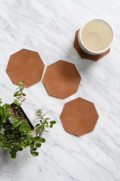 Protect your tables in style! What's more chic than bold geometric shapes & a glass of Merlot on a Friday night in with your closest gal pals? - Set of 4 - Handmade in Addis Ababa, Ethiopia with love leather coasters handmade Geometric Leather Coasters Diy Leather Goods, Kitchen Cabinet Kings, Leather Coasters, Diy Coasters, Leather Projects, Leather Crafts, Sewing Leather, Leather Accessories, Leather Working