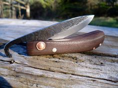 Hand forged friction folding knife: File steel/walnut