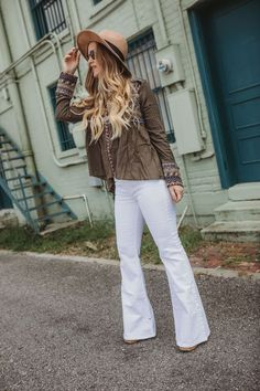 Boho flared jeans outfit with white jeans and embroidered top