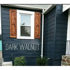 Dark blue house with walnut shutters and white window trim Wood Shutters Rustic exterior cedar shutters Shaker Exterior Paint Colors For House, Paint Colors For Home, Navy House Exterior, Siding Colors For Houses, Outdoor House Colors, Outside House Paint Colors, Houses With Shutters, Diy Exterior House Painting, Exterior Paint Ideas