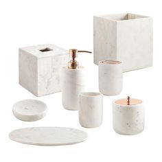 Our Pietra bath accessories are a stunning addition to your bathroom's decor. Crafted from Calacatta marble, each piece is particularly unique given the natural multitone veining characteristic of this kind of marble and features details in stainless steel with an electroplated rose gold finish. Made by Kassatex.