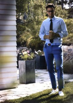 Go for a classic style in a baby blue oxford shirt and blue dress pants.  White leather loafers are the right shoes here to get you noticed. 5fdac2f05ad26