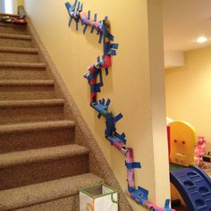 :)  TP and paper towel tube marble run for bouncy balls - oh what fun for a rainy day! Use the blue removable painter's tape!