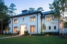 Love cream/off white home exterior with bronze windows. Thompson Custom Homes