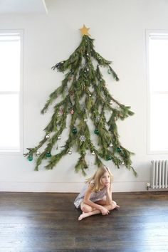 a wall mounted Christmas tree featuring a natural silhouette and made of real branches, decorated with various ornaments Christmas Tree Poster, Creative Christmas Trees, Diy Christmas Garland, Diy Garland, Noel Christmas, Modern Christmas, Xmas Tree, Beautiful Christmas, Christmas Crafts