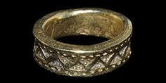 VIKING GOLD PUNCH DECORATED RING. 9th-11th century CE. A sturdy Viking period finger ring decorated with offset pellet-in-triangle punchmarks within borders of pellets. Gold, 24.80 grams, 27 mm external diameter (approximate size UK Y, USA 12, Europe 27.51, Japan 26). Very fine condition. Rare.