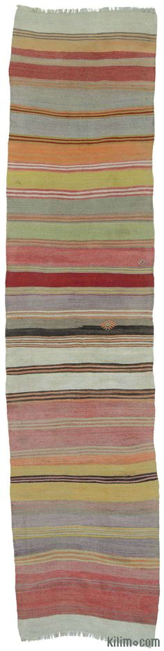 Striped vintage Turkish kilim runner rug around 40 years old and in very good condition.