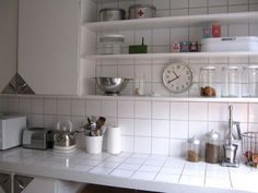 Open shelves in a kitchen with a few accessories