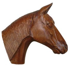 carving a horse's head. Wood carving is part of African culture, especially with people from West Africa.