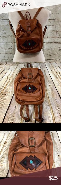 Southwest Style  Leather Backpack Handbag Purse Southwest Style Brown Leather Backpack Shoulder Sling Handbag Purse  Item is in good clean condition. Piece measures approximately 10 inches in height and 7 inches across. Please see all photos and do not hesitate to send me any additional questions. unbranded Bags Backpacks