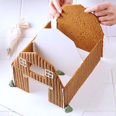 gingerbread house template A classic gingerbread house is a sweet way to warm your winter home decor. An entire woodland wonderland, however, takes the edible art concept to Gingerbread House Template, Gingerbread House Designs, Gingerbread House Parties, Gingerbread Village, Christmas Gingerbread House, Gingerbread Man, Christmas Goodies, Christmas Treats, Christmas Baking