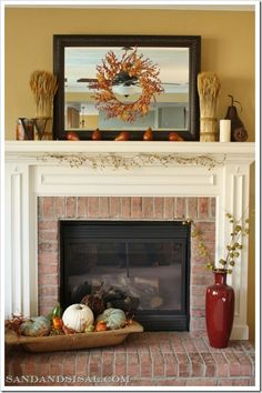 A great #mantel arrangement!  The wreath in the center of this #framed #mirror adds a lot of interest to the space and helps make the room appear larger.  Great idea!