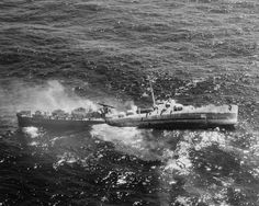 WWII - Destroyer Escort USS Fiske broken in two and sinking in the North Atlantic after being torpedoed by German submarine U-804, 2 August 1944.