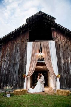 Drakewoodfarm Outdoor wedding drapery in ivory and beige drapery for barn wedding