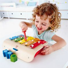 The Hape Shape Sorter Xylophone is 3 toys rolled into one. The multifunctional Shape Sorter Xylophone is a piano, xylophone and shape sorting game all rolled into one. Instrument Percussion, Hopscotch Kids, Sorting Games, Shape Sort, Instruments, Toy Catalogs, Presents For Boys, Girls Vacation, Best Kids Toys